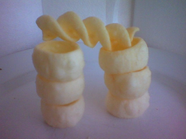 Two towers of ring chips with a curly chip between them.