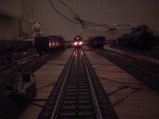 Looking down the track at night, two lights stare back at us!
