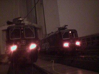 Two beautiful locomotives with powerful lights.